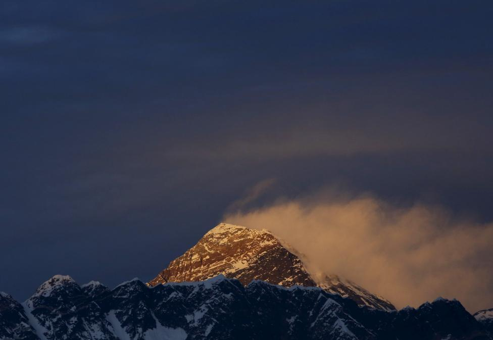 Light illuminates Mount Everest, during sunset in Solukhumbu District also known as the Everest region