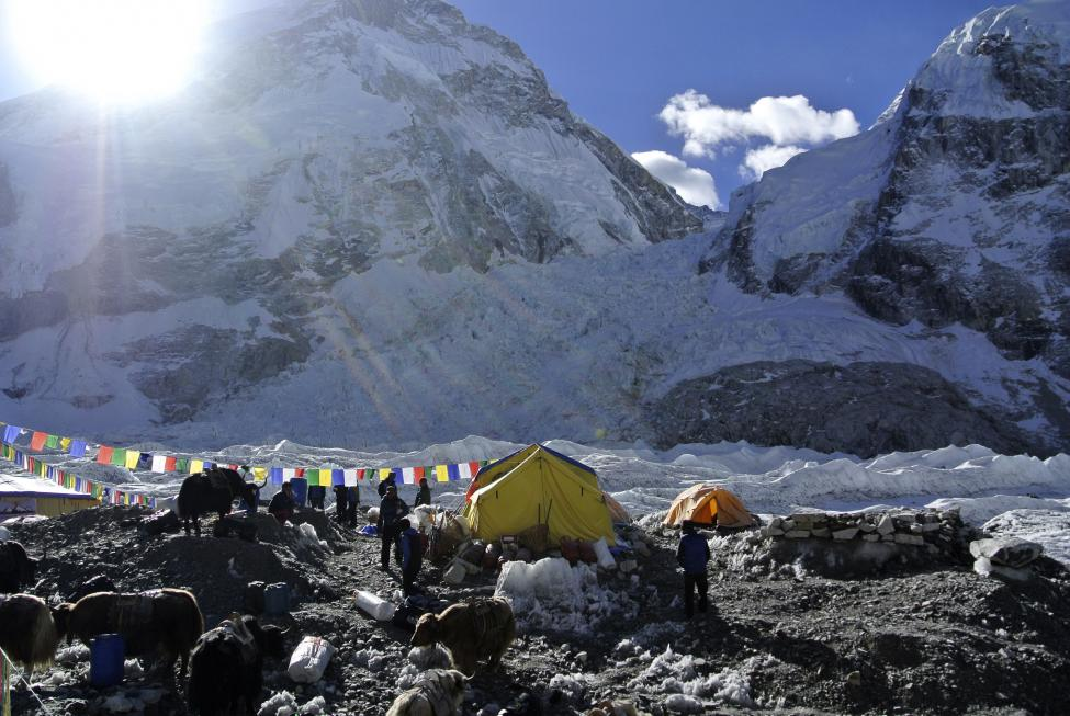Sherpas spend time near their tents after their Mount Everest expeditions were cancelled in Solukhumbu