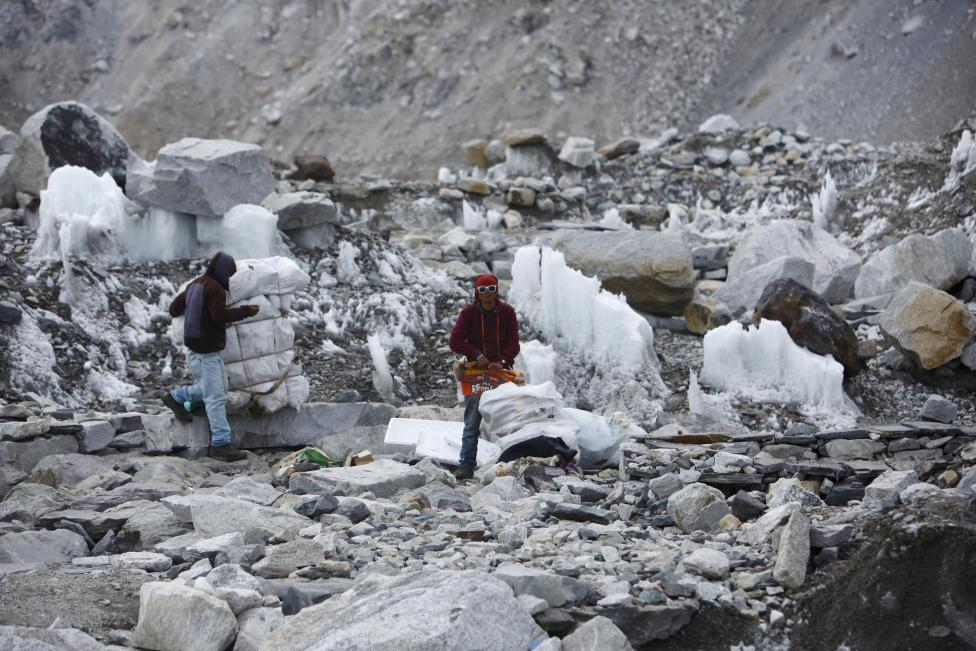 Garbage collectors collect rubbish at the Everest base camp in Solukhumbu District