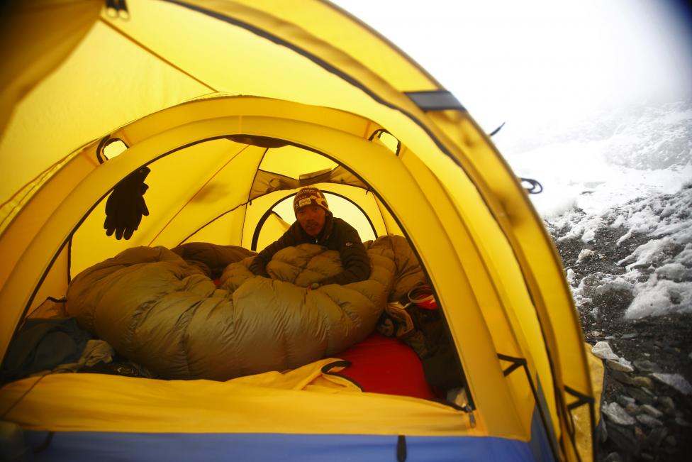 Phurba Tenzing Sherpa sits inside his tent at Everest Base camp in Solukhumbu District