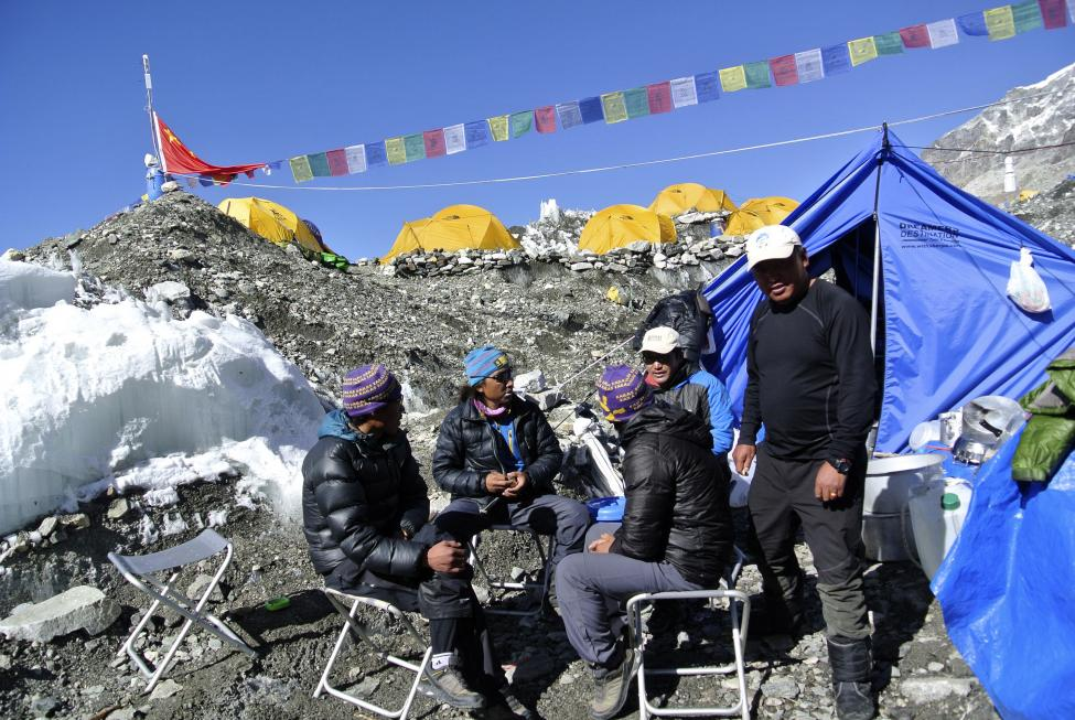 Sherpas sit at the base camp after a Mount Everest expedition was cancelled in Solukhumbu district